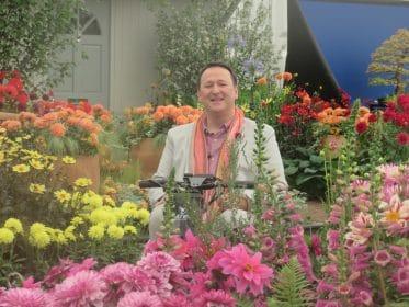 Mark Lane Designs, Mark Lane enjoying the blooms at RHS Chelsea Flower Show